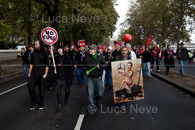 Kaya Mar (Painter and political caricaturist).<br /> <br /> London, 20/10/2012. Today, hundreds of thousands of people marched through central London (From Victoria Embankment to Hyde Park) taking part in a demonstration organised by the Trades Union Congress (TUC). The rally sought to highlight the failures of austerity measures implemented by the coalition Government. At the end of the rally, a small number of protesters left the march moving to Oxford Street where they protested against various retail outlets including: Starbucks, Marks and Spencer, Primark, Boots, McDonald's and Vodafone, all of which are accused of tax avoidance or use/abuse of the workfare scheme.<br /> <br /> For more information about the Artist please click here: http://www.kayamar.co.uk