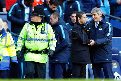 05.03.2016. The Etihad, Manchester, England. Barclays Premier League. Manchester City versus Aston Villa. Aston Villa Manager Remi Garde shakes hands with Manchester City Manager Manuel Pellegrini at the end of the game