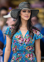 BALTIMORE, MD - MAY 20: A woman walks in the grandstand on Preakness Stakes Day at Pimlico Race Course on May 20, 2017 in Baltimore, Maryland.(Photo by Douglas DeFelice/Eclipse Sportswire/Getty Images)