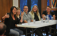 NWA Democrat-Gazette/MICHAEL WOODS --05/16/2015--w@NWAMICHAELW...  Members of the LGBT community (left to right) Justine Morgan Turnage, Cathy Campbell, President of NWA PFLAG, Raymond M. Sweet, Rev. Gwen Fry, Episcopal priest, and Stephanie Mott, founder and executive director of Kansas Statewide Transgender Education Project, answer questions during a discussion panel Saturday evening hosted by the Unitarian-Universalists in Fayetteville as they share their faith stories with the public.