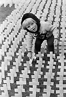 Witness for Peace Remembrance Service - 1363 crosses were planted for the then total of dead in the N Ireland Troubles. In this picture 3 year old Patricia McCullough plants a cross for the dead brother she never knew. Patrick McCullough was shot dead on the Limestone Road, Belfast, whilst  coming home from Mass at his local church. Ref: 197511001.<br />