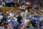 06 February 2012: Duke's Chelsea Gray (12) jumps for a shot against North Carolina's Brittany Rountree (11). The Duke University Blue Devils defeated the University of North Carolina Tar Heels 96-56 at Cameron Indoor Stadium in Durham, North Carolina in an NCAA Division I Women's basketball game.