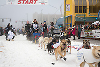 Kristy Berington and team leave the ceremonial start line at 4th Avenue and D street in downtown Anchorage during the 2013 Iditarod race. Photo by Jim R. Kohl/IditarodPhotos.com