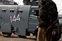 A police vehicle bears the number 144. Section 144 is also a law used to ban people from gathering in groups of more than three. Paramilitary police enforced a curfew imposed to stop separists gather for a political demonstration in Srinagar, Kashmir, India. © Fredrik Naumann/Felix Features