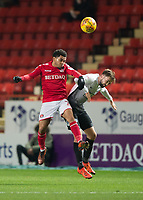 Jay Dasilva of Charlton Athletic and Gwion Edwards of Peterborough United in action during the Sky Bet League 1 match between Charlton Athletic and Peterborough at The Valley, London, England on 28 November 2017. Photo by Vince  Mignott / PRiME Media Images.