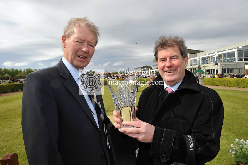 "13-5-2012: ""Ta a lan arus orm......"" Race commentator Micheal O'Muircheartaigh with  JP McManus who proudly holds aloft the trophy after his horse 'Shot from the Hip ' won at Killarney races 'La na Gaeilgie' on Sunday..Picture by Don MacMonagle"