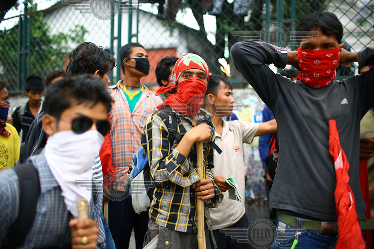 Young people wear masks to protect themselves from tear gas at a strike called by the Unified Communist Party of Nepal (UCPN) to remove the ruling government. The Maoist opposition blocked streets leading to key government offices on the 6th May, the fifth day of their crippling general strike to demand the prime minister's resignation, but the government has vowed not to bow to the protesters' pressure. The Maoists, known to use violence to back their strike calls, have demanded that residents halt all travel and keep businesses and schools closed since Sunday in their campaign to get Prime Minister Madhav Kumar Nepal to resign and hand power to a Maoist-led government. The strike has shut down most businesses, schools and transport, with daily activity grinding to a standstill.