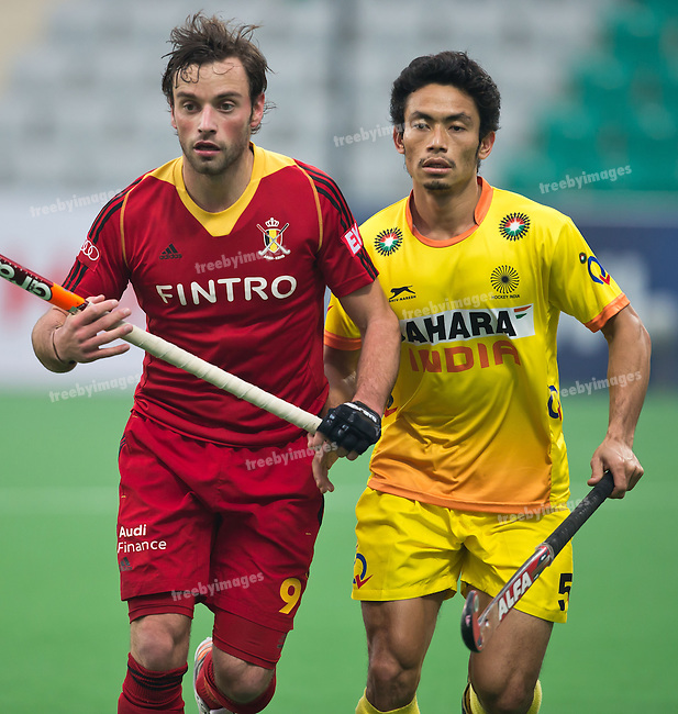 Mens Hockey World league Final Delhi 2014<br /> Day 6, 18-01-2014<br /> Position 5-6 Belgium v India<br /> Seb Dockier of Belgium and Aiyappa Mukkatira of India<br /> <br /> Photo: Grant Treeby / treebyimages