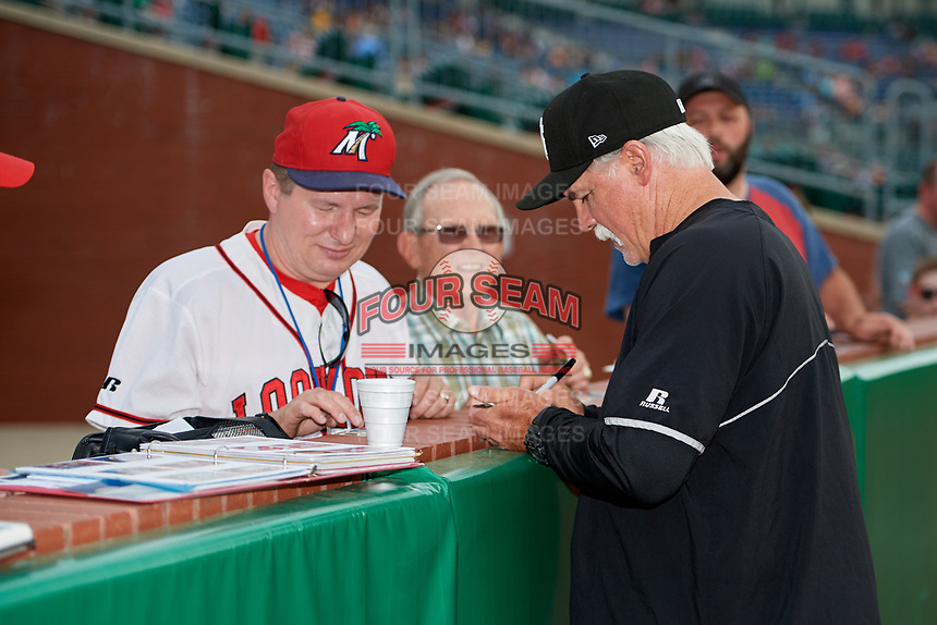 Jackson Generals pitching coach Doug Drabek (15) signs autographs for fans before a game against the Chattanooga Lookouts on May 9, 2018 at AT&T Field in Chattanooga, Tennessee.  Chattanooga defeated Jackson 4-2.  (Mike Janes/Four Seam Images)