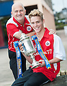 Stirling Albion Operations Director, Stuart Brown and player Sandy Cunningham get a hold of the William Hill Scottish Cup prior to their second round match against Whitehill Welfare.