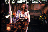 Japanese local woman eating at Yamagen noodle shop, Honolulu, Oahu