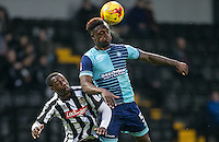 Anthony Stewart of Wycombe Wanderers beats Jonathan Forte of Notts Co in the air during the Sky Bet League 2 match between Notts County and Wycombe Wanderers at Meadow Lane, Nottingham, England on 10 December 2016. Photo by Andy Rowland.