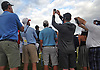 A crowd of spectators gather around Tiger Woods, third from left, as he prepares to hit off the tee on the 18th Hole during the first round of the U.S. Open Championship at Shinnecock Hills Golf Club in Southampton on Thursday, June 14, 2018.