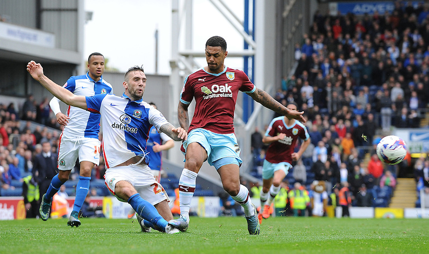Burnley's Andre Gray fouls Blackburn Rovers' Shane Duffy<br /> <br /> Photographer Dave Howarth/CameraSport<br /> <br /> Football - The Football League Sky Bet Championship - Blackburn Rovers v Burnley - Saturday 24th October 2015 - Ewood Park - Blackburn<br /> <br /> &copy; CameraSport - 43 Linden Ave. Countesthorpe. Leicester. England. LE8 5PG - Tel: +44 (0) 116 277 4147 - admin@camerasport.com - www.camerasport.com
