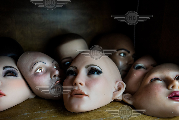 The heads of sex dolls lie on a shelf inside the San Marcos headquarters of Real Dolls. The Real Doll is a high-end sex doll created by Matt McMullen. Mr McMullen is now trying to combine different technologies to make a sex robot. He is experimenting with Artificial Intelligence, Virtual Reality and Animatronics.