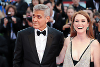 U.S. director George Clooney, left, and actress Julianne Moore walk on the red carpet for the screening of the movie 'Suburbicon' at the 74th Venice Film Festival, Venice Lido, September 2, 2017. <br /> UPDATE IMAGES PRESS/Marilla Sicilia<br /> <br /> *** ONLY FRANCE AND GERMANY SALES ***
