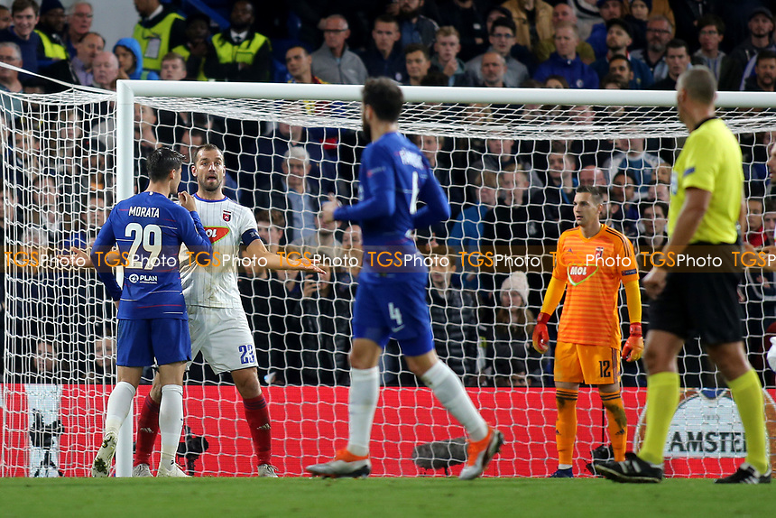 Chelsea's Alvaro Morata confronts Mol Vidi's Roland Juhasz after clashing in the Mol Vidi penalty area during Chelsea vs MOL Vidi, UEFA Europa League Football at Stamford Bridge on 4th October 2018