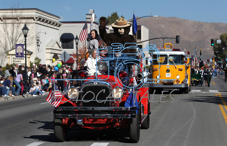 Smokey Bear and the Warren Engine Company ride in the annual Nevada Day Parade in Carson City, Nev., on Saturday, Oct. 28, 2011..Photo by Cathleen Allison