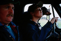 His father and dog watch the road while his teenage son learns to drive a pickup truck on the family farm. Such is the rite of passage for youth in rural areas.