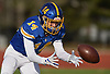 Frankie Roder #14 of Kellenberg fields a kick during the NYCHSFL Class AA final against Xavier (Manhattan) at Mitchel Athletic Complex in Uniondale on Saturday, Nov. 17, 2018. Kellenberg won by a score of 41-6.