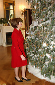 The White House Christmas decorations were shown to the press on December 3, 2001.  Even though the Executive Mansion has been closed to tourists since the 9/11 terrorist attacks, the annual ritual of decorating the house continues.  First lady Laura Bush looks at some of the decorations of the White House Christmas Tree in the Blue Room of the White House.<br /> Credit: Ron Sachs / CNP