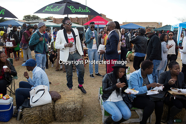 SOWETO, SOUTH AFRICA JULY 6: Sibu Sithole, (c) a young designer part of the group Smarteez at an outdoor market on July 6, 2014 in Orlando West section of Soweto, South Africa. Soweto today is a mix of old housing and newly constructed townhouses. A new hungry black middle-class is growing steadily. Many residents work in Johannesburg but the last years many shopping malls have been built, and people are starting to spend their money in Soweto. (Photo by: Per-Anders Pettersson)