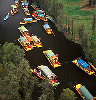 aerial photograph of boats floating on the edge of the Xochimilco canals, Mexico City, Mexico