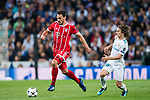 Mats Hummels (L) of FC Bayern Munich is followed by Luka Modric of Real Madrid during the UEFA Champions League Semi-final 2nd leg match between Real Madrid and Bayern Munich at the Estadio Santiago Bernabeu on May 01 2018 in Madrid, Spain. Photo by Diego Souto / Power Sport Images