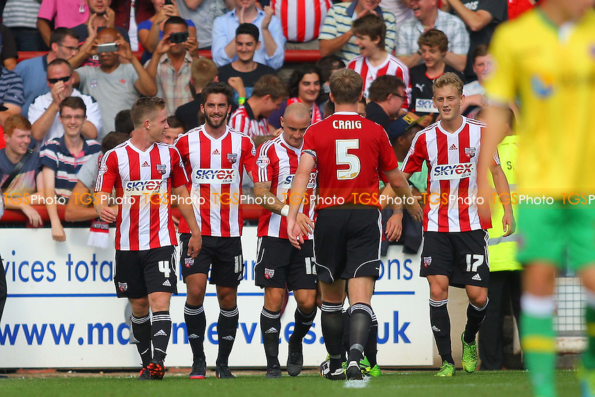 Will Grigg of Brentford (centre) scores his second goal and celebrates - Brentford vs Sheffield United - Sky Bet League One Football at Griffin Park, Brentford, London - 10/08/13 - MANDATORY CREDIT: George Phillipou/TGSPHOTO - Self billing applies where appropriate - 0845 094 6026 - contact@tgsphoto.co.uk - NO UNPAID USE