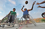 Alejandro Jarquin (left) and Bartolome Martinez battle over the basketball during practice in Zipolite, a town in Oaxaca, Mexico. Jarquin and Martinez are part of the Oaxaca Costa wheelchair basketball team.