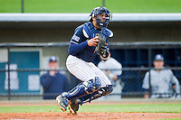 UNCG Spartans catcher Cambric Moye (30) checks the runner at first after fielding a throw at home plate during the game against the Georgia Southern Eagles at UNCG Baseball Stadium on March 29, 2013 in Greensboro, North Carolina.  The Spartans defeated the Eagles 5-4.  (Brian Westerholt/Four Seam Images)