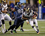 St. Louis Rams running back Steven Jackson is tackled by Seattle Seahawks linebacker Leroy Hill at  CenturyLink Field in Seattle, Washington on December 12, 2011. The Seahawks beat the Rams 30-13. ©2011 Jim Bryant Photo. All Rights Reserved.