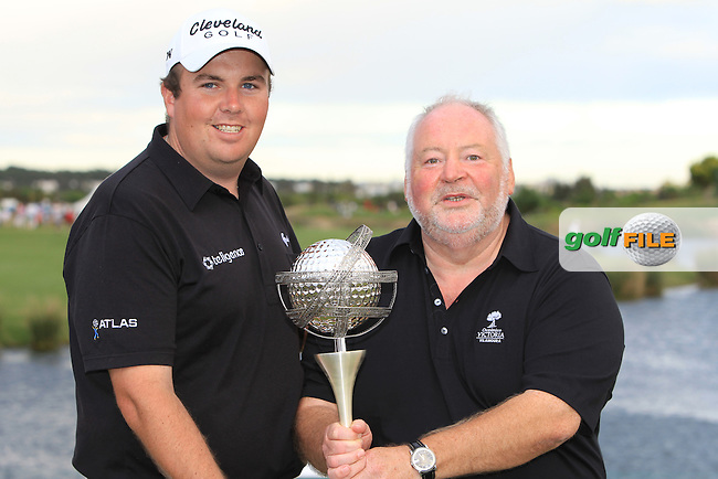 Shane Lowry (IRL) with Gerry Fagan Oceanico CEO after winning the tournament at the end of Sunday's Final Round of the Portugal Masters at the Oceanico Victoria Golf Course, Vilamoura, Portugal 14th October 2012 (Photo Eoin Clarke/www.golffile.ie)