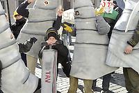 Roma, 3 Dicembre 2012.Piazza Farnese.Militanti No Tav costruisono un finto cantiere in gomma piuma davanti l'ambasciata di Francia,vestiti da operai con trivelle, tralicci, picconi e caschetti..Manifestano contro la costruzione dell'alta velocità in Val di Susa  in contemporanea con il vertice in Francia..Chiedono la liberazione degli attivisti arrestati