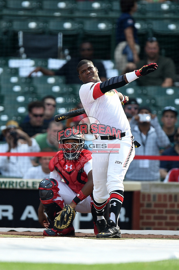Starling Heredia (24) of Santo Domingo, Dominican Republic representing the Dominican Prospect League during the home run derby before the Under Armour All-American Game on August 16, 2014 at Wrigley Field in Chicago, Illinois.  (Mike Janes/Four Seam Images)