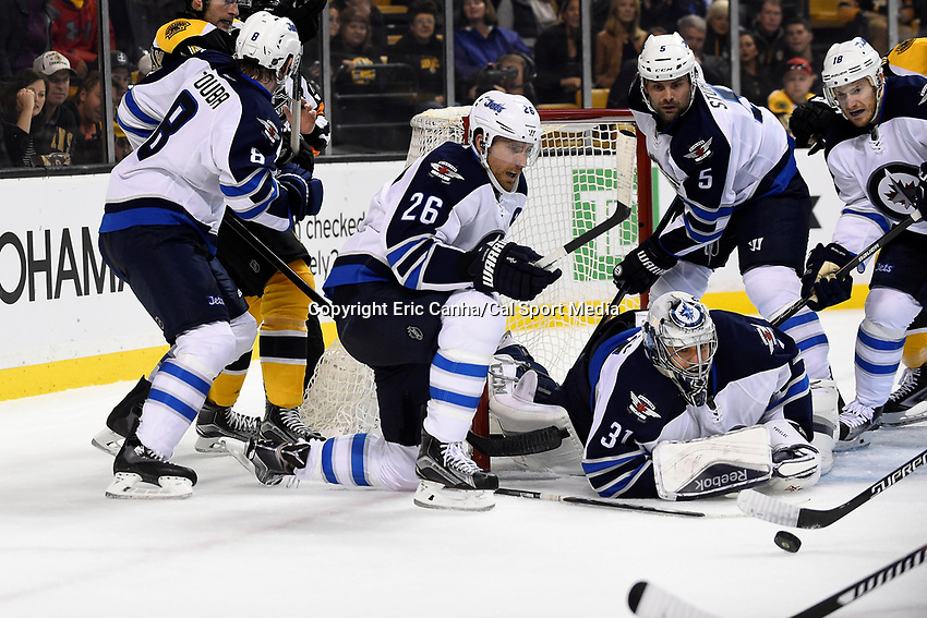 Thursday, October 8, 2015: Winnipeg Jets goalie Ondrej Pavelec (31) loses his stick while protecting the goal during the NHL game between the Winnipeg Jets and the Boston Bruins held at TD Garden, in Boston, Massachusetts. Eric Canha/CSM