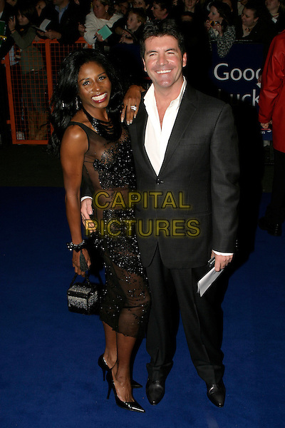 SINITTA & SIMON COWELL.National Television Awards 2005 at the Royal Albert Hall, SW7, London, UK..October 25th, 2005.Ref: AH.full length black lace dress suit .www.capitalpictures.com.sales@capitalpictures.com.© Capital Pictures.