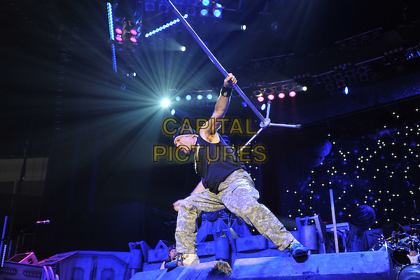 Iron Maiden.Performing live at the O2 Arena, London, England..August 5th, 2011.stage concert live gig performance music full length grey gray trousers black top hat arm in air microphone stand .CAP/MAR.© Martin Harris/Capital Pictures.