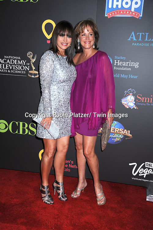 Crystal Chappell and Hillary B Smith arriving at the 38th Annual Daytime Emmy Awards  on June 19, 2011 at The Las Vegas Hilton in Las Vegas Nevada. ..