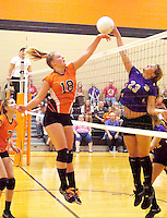 Photo by Randy Moll<br /> Stephanie Pinter, Gravette junior, has a shot blocked by Berryville junior Melody Smith during play at Gravette High School on Thursday, Sept. 10, 2015.