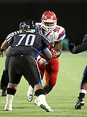Manatee Hurricanes defensive lineman DeMarcus Christmas #90 rushes the quarterback during the first quarter of the Florida High School Athletic Association 7A Championship Game at Florida's Citrus Bowl on December 16, 2011 in Orlando, Florida.  The score at halftime is Manatee 17 - First Coast 0.  (Photo By Mike Janes Photography)