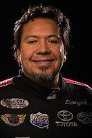 Jan 15, 2015; Jupiter, FL, USA; NHRA funny car driver Cruz Pedregon poses for a portrait during preseason testing at Palm Beach International Raceway. Mandatory Credit: Mark J. Rebilas-USA TODAY Sports