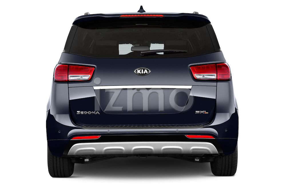 Straight rear view of a 2015 KIA Sedona LX Hybrid 5 Door Mini Van stock images