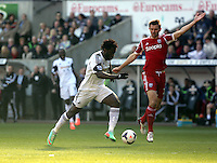 Saturday, 15 March 2014<br /> Pictured: Wilfried Bony of Swansea (L) charges forward only to be off side<br /> Re: Barclay's Premier League, Swansea City FC v West Bromwich Albion at the Liberty Stadium, south Wales, UK.