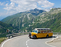 Switzerland, Canton Valais, Old Swiss Postauto at Furka Pass Road, Grimsel Pass Road in the Background