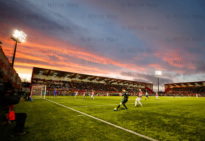 Brandon Barker sets up a Hibs attack in the box as the winter sun sets at Hamilton