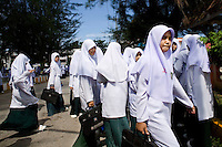 Muslim girls after a day at the Saiburi Islam Wittaya school in the Saiburi district. Thailand is struggling to keep up appearances as the land of smiles has to face up to its troubled south. Since 2004 more than 3500 people have been killed and 4000 wounded in a war we never hear about. In the early hours of January 4th 2004 more than 50 armed men stormed a army weapons depot in Narathiwat taking assault rifles, machine guns, rocket launchers, pistols, rocket-propelled grenades and other ammunition. Arsonists simultaneously attacked 20 schools and three police posts elsewhere in Narathiwat. The raid marked the start of the deadliest period of armed conflict in the century-long insurgency. Despite some 30,000 Thai troops being deployed in the region, the shootings, grenade attacks and car bombings happen almost daily, with 90 per cent of those killed being civilians. 23.09.07. Photo: Christopher Olssøn