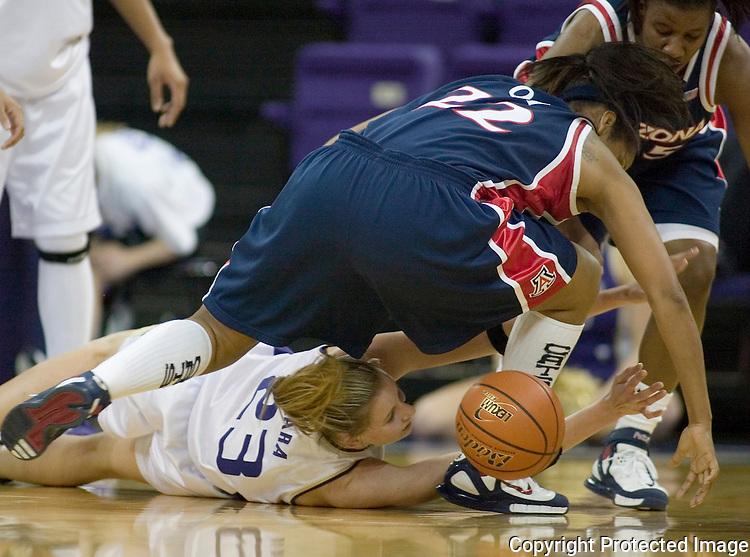 Washington's Maggie O'Hara (23) battles a loose ball with Arizona's Che Oh (22) and Joy Hollingsworth ,back, during second half action in women's college basketball, Thursday, Jan.26 , 2006 in Seattle. Washington beat Arizona 91-73. (AP Photo/Jim Bryant).