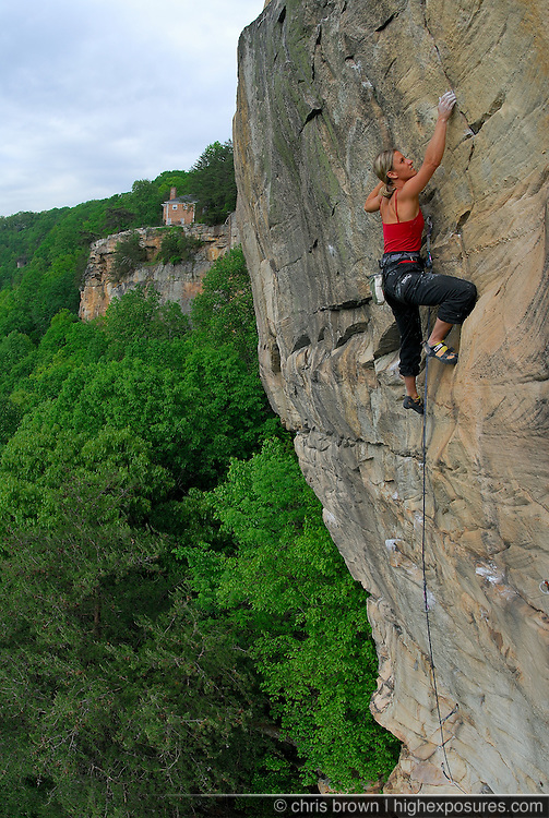 Michelle Smith climbs the flanks of Lookout Mountain below an overlooking home.