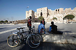 Children use the plaza in front of the main entrance of the Citadel in Aleppo, Syria on November 07, 2010. (Salah Malkawi)